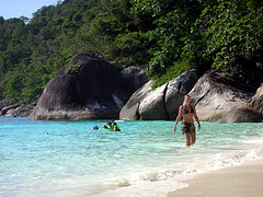 Visitor walks on white sandy beach during Similan Island Speedboat Day Tours Trips