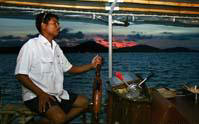 Captain drives June Bahtra Sunset Dinner Cruise into Phang Nga Bay