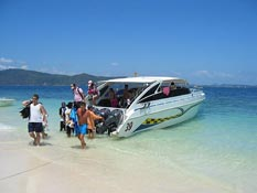 Coral Island by speedboat on crystal water