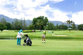 Picture of green course with player at Laguna Phuket Golf Club