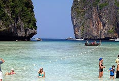 Tour Package Phuket Island with our famous Poda Island sitting on the water.