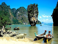 Rock on Phang Nga Bay speedboat tours with green water and mangrove