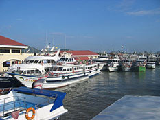 Phi Phi Island Cruiser Tours Big Boat parking at Rassada Pier with other companies' charters