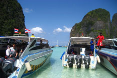2 Phuket Private Boat Charter rental on water at Phi Phi Island.