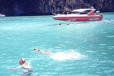 Phuket Private Speedboat with photo of guest enjoy snorkeling